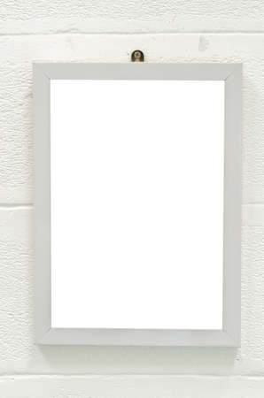 Empty wood frame on white wall photo