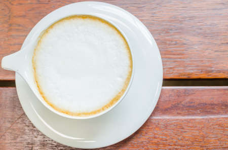 Hot coffee cappuccino in white cup photo
