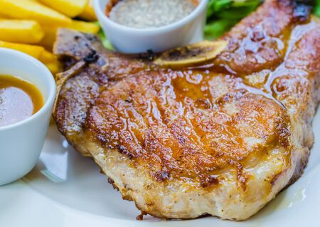 Pork chop steak on wood table photo