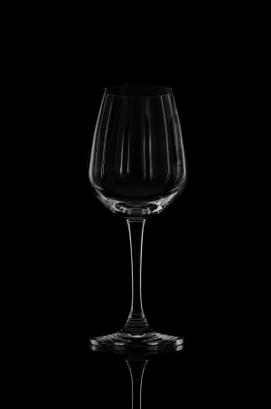 Wine glass on black wallpaper photo