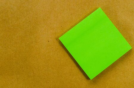 Color paper note on the brown background photo
