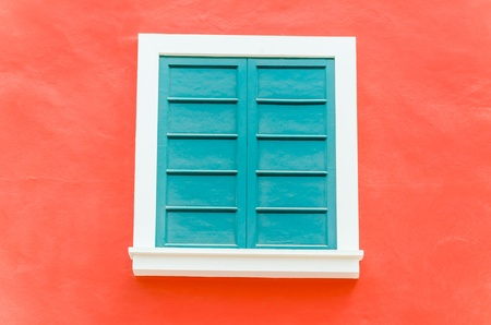 Beautiful window on color wall photo