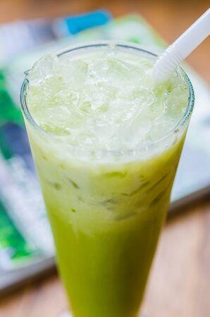 Ice green tea on wood table photo