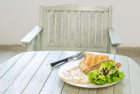 Breakfast on wood table photo