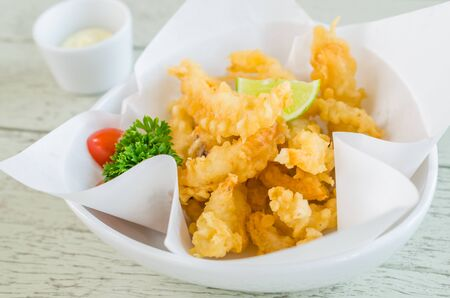 Fried Squid on wood table photo
