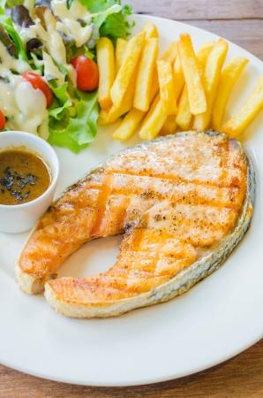 Salmon Steak on wood table Standard-Bild
