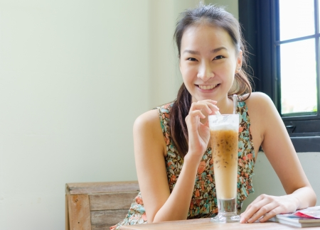 Girl smiling with ice coffee photo