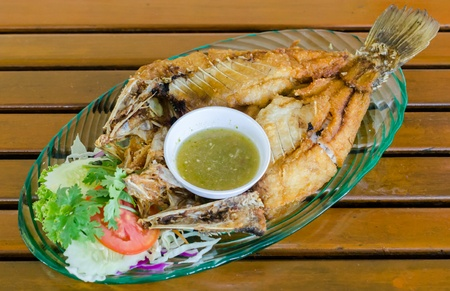 Fried fish with spicy sauce photo