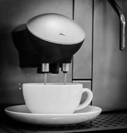 Coffee out from machine (Process in old black&white style) photo