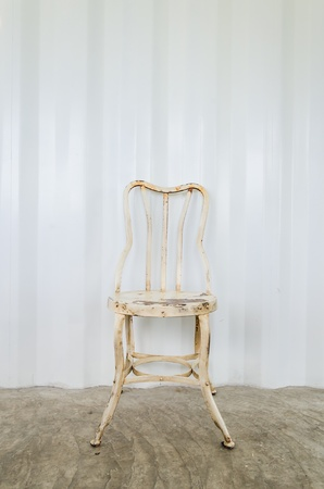 Old vintage chair on gray wall photo
