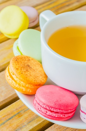 cup tea: Colorful macaroon with white cup tea