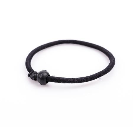 scrunchie: Black hairbands on white background