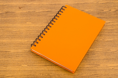 Note book on wood background photo