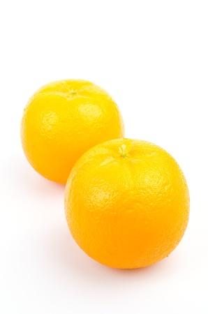 Fake orange on white background photo