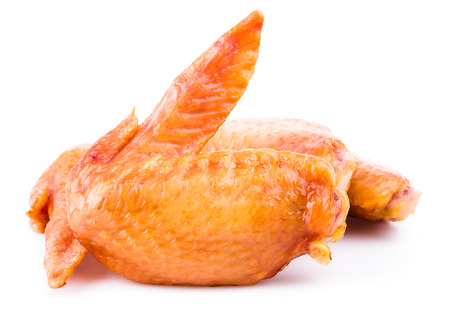 Smoked chicken wings on white background Stock Photo - 22204494