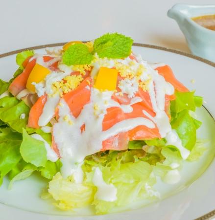 Salad salmon in white dish photo