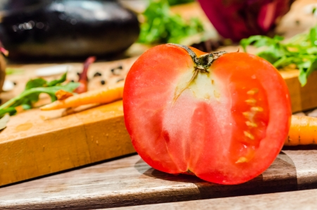 Tomato and vegetable (still life) photo