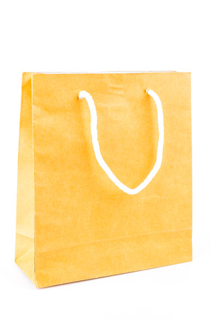 Brown paper bag on white background photo