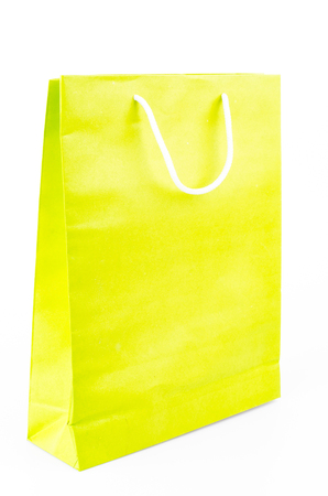 Green paper bag on white background photo