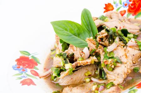 Spicy pork salad (Thai food) photo