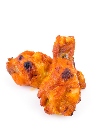 Spicy chicken wings on white background photo