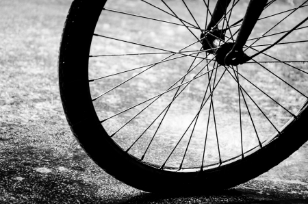 Abstract Bicycle wheel in black and white style photo