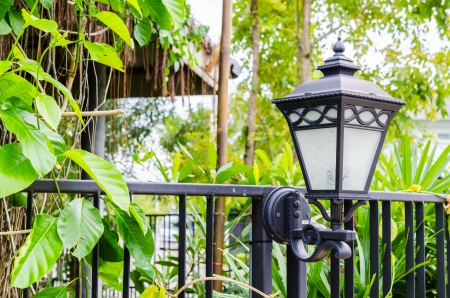 Lamp in the garden on the wall photo