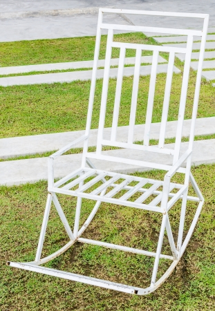 White chair in green grass photo