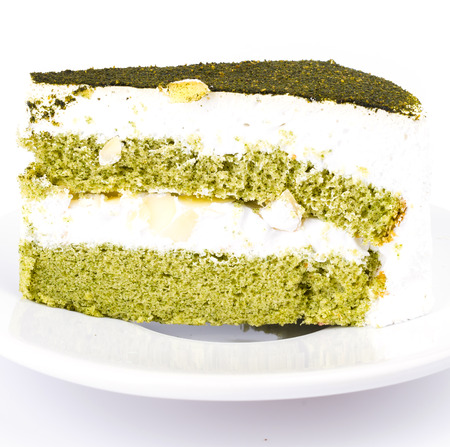 Green tea cake on white background photo