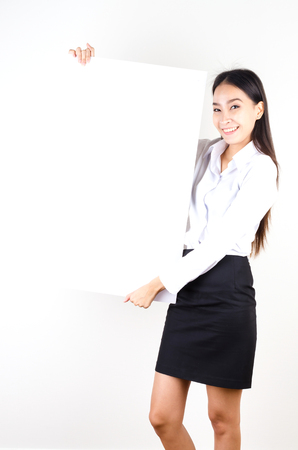 Young asian business women show empty board photo