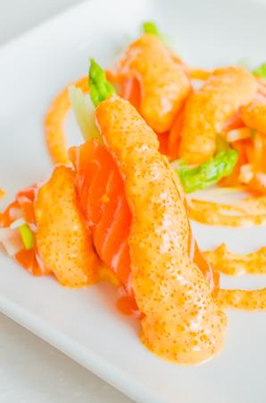 Salmon roll in white dish photo