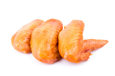 Smoked chicken wings  isolated on white photo