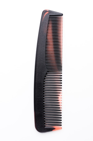 hairstylists: Pocket comb on isolated white  Stock Photo