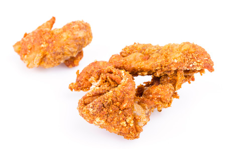 Fried chicken skin on white background photo