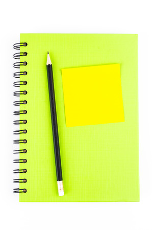 Note pad on notebook and pencil on isolated white background Stock Photo - 22976038