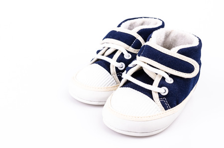 Baby shoe on isolated white background photo