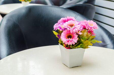 Fake flowers in vase photo