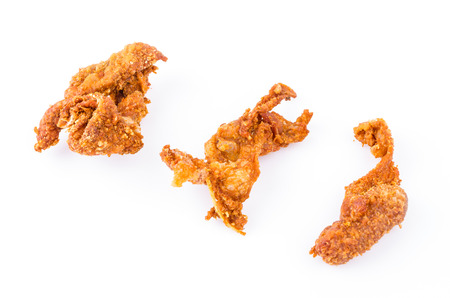 Fried chicken skin on white  photo