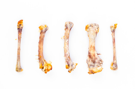soggy: Chicken wings bones on white  Stock Photo
