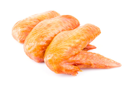 Smoked chicken wings on white background Stock Photo - 23770290