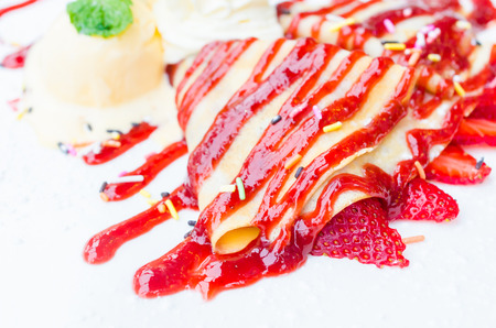 Strawberry crepe and icecream photo