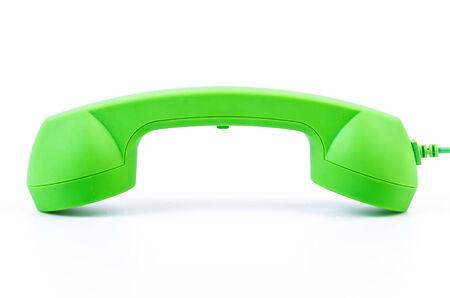 telecommunicate: Green telephone on isolated white background