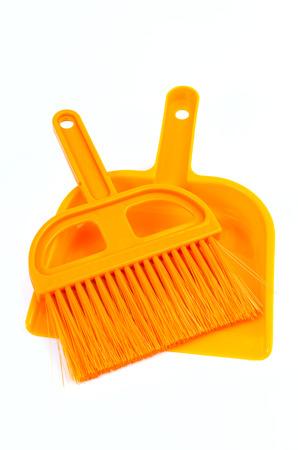 Plastic broom on isolated white background photo