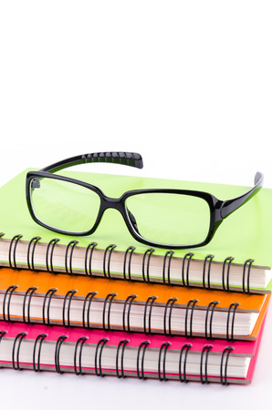 Eye glasses on book photo