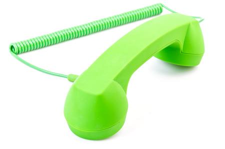 Green telephone on isolated white background photo