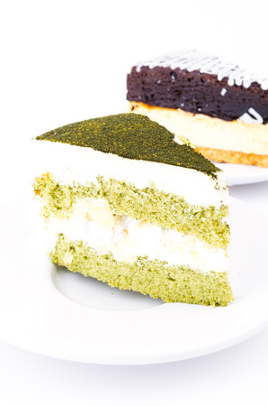 Green tea cake and brownie cheese cake on white background photo