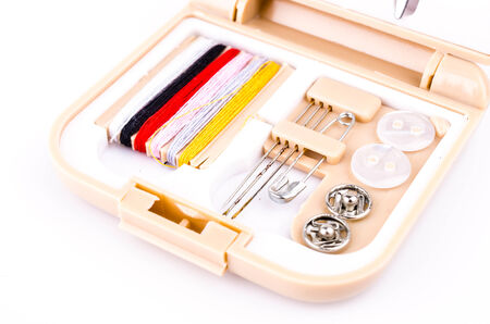 Sewing kit on white background photo