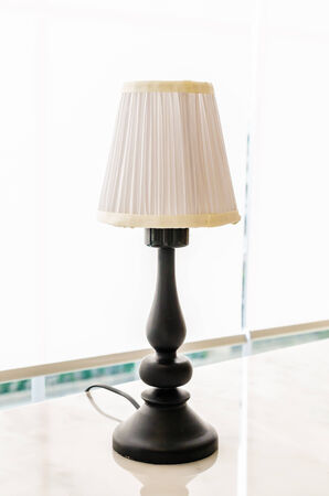 Lamp on the table photo
