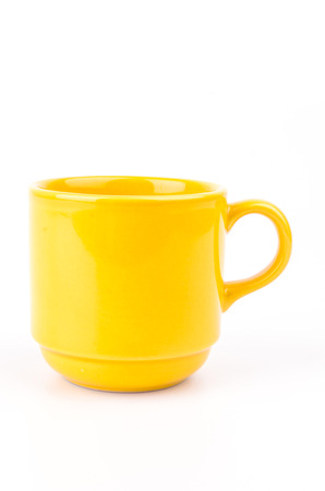 Yellow cup on white background photo
