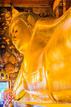 reclining Buddha in wat pho bangkok thailand photo